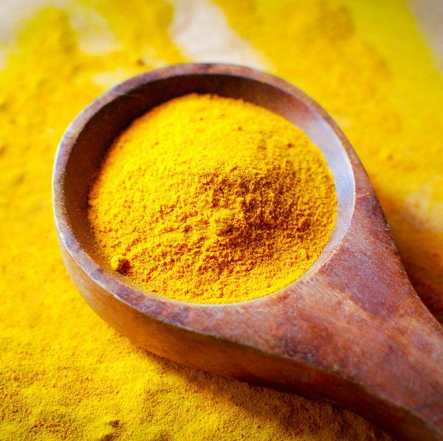 turmeric powder   wooden spoon