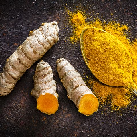 spices turmeric roots and powder shot from above
