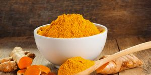 Turmeric roots with turmeric powder