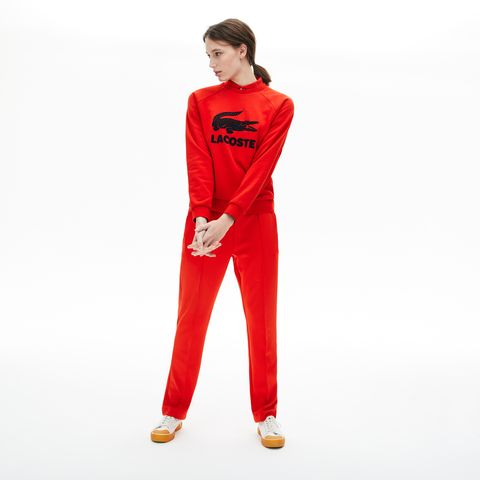 Clothing, Red, Sportswear, Pajamas, Standing, Trousers, sweatpant, Nightwear, Suit, Active pants,