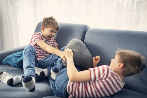 twin boys fighting at home