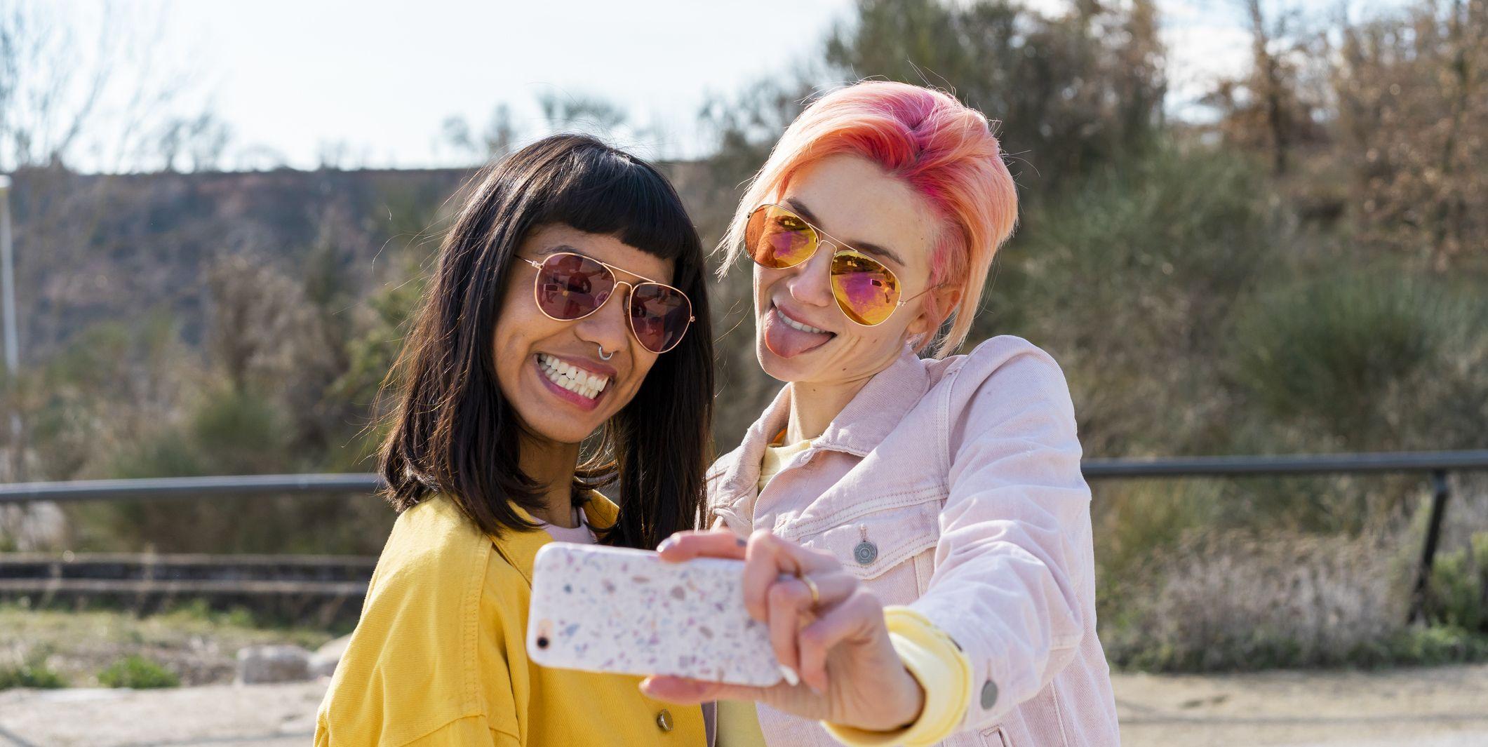 Two alternative friends taking selfie