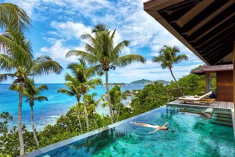 Resort, Swimming pool, Vacation, Property, Caribbean, Tropics, House, Leisure, Real estate, Azure,