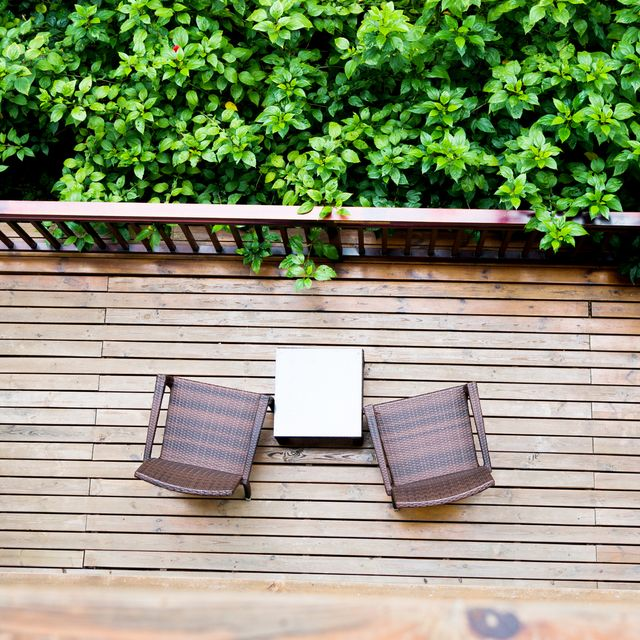 Two chairs in a balcony garden