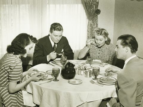 Two couples having dinner, (B&W)