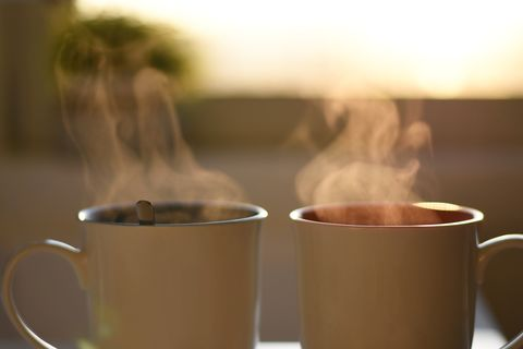two cups of hot steaming coffee