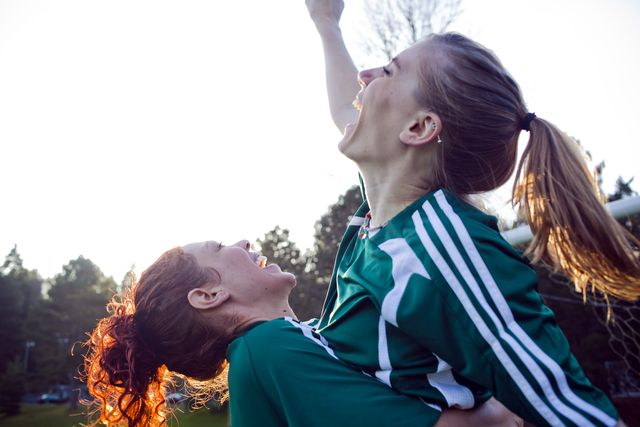 two female friends cheering