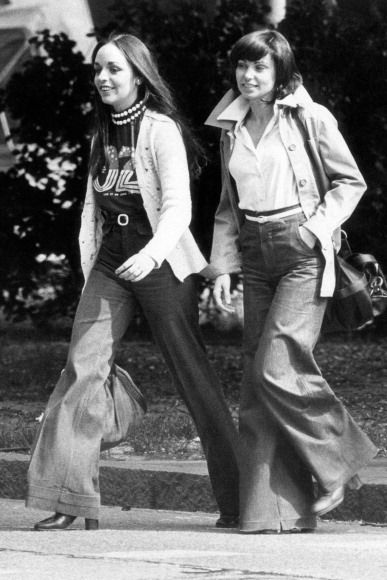 Two girls in jeans walking