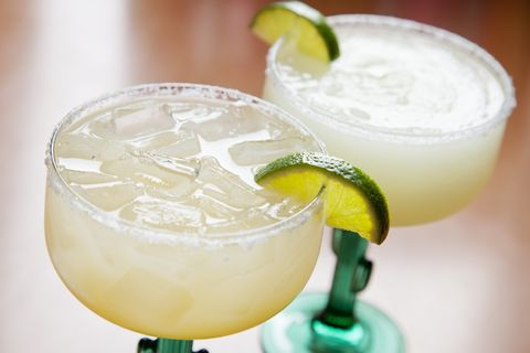 two glasses of classic margarita on the rocks and blended