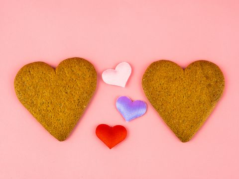 two heart shaped ginger cookies and three colored hearts love and romanticism concept