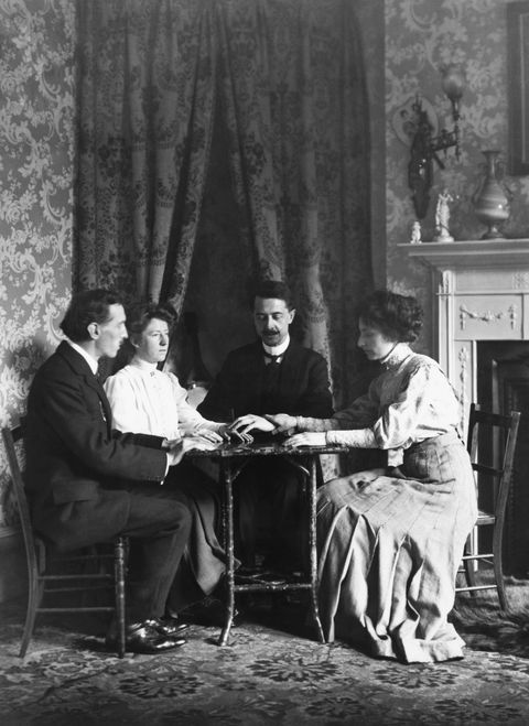 men and women in seance halloween tradition