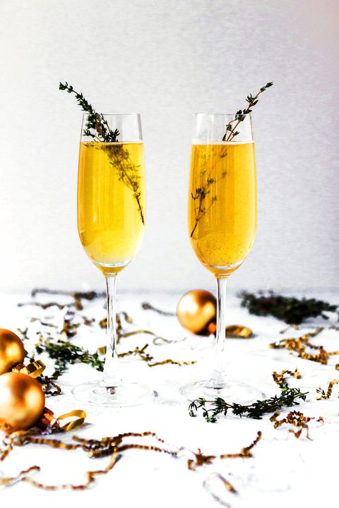 Champagne cocktail, Drink, Alcoholic beverage, Bellini, Juice, Champagne stemware, Cocktail, Yellow, Mimosa, Champagne,