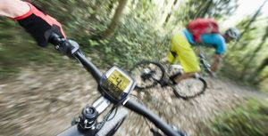 Two Mountainbikers racing down mountain track