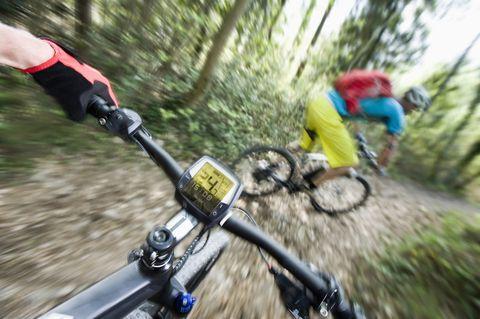 Two Mountainbikers racing down mountain track