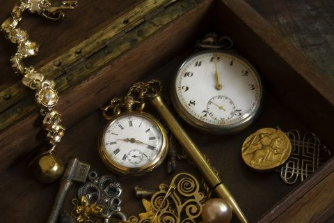two old pocket watches inside a box still life