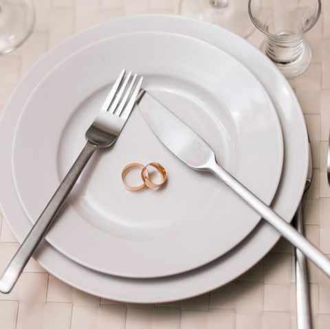 two rings on a plate with serving fork, spoon, knife.