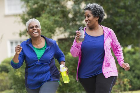 Two senior black women exercising together