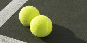 Two tennis balls on tennis court, elevated view