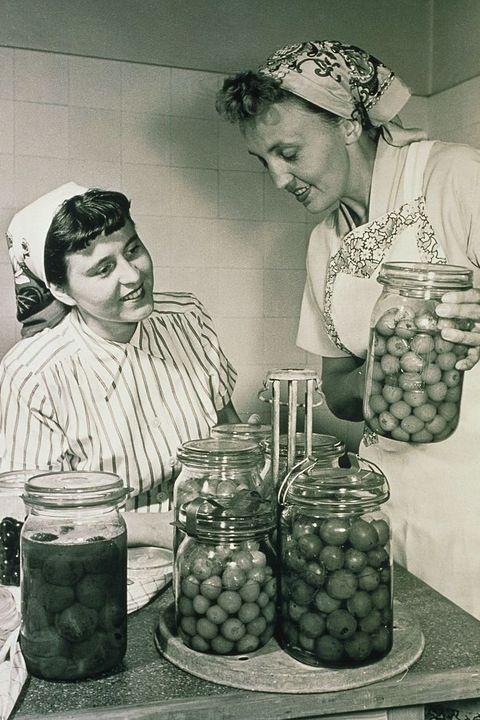 women preserving food
