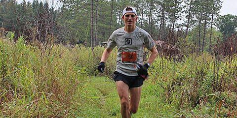 Tyler Sigl running on trail