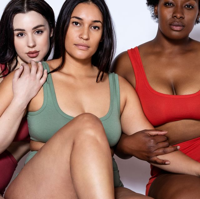 types of boobs multi ethnic women sitting together on studio floor group of oversize women in underwear together over white background