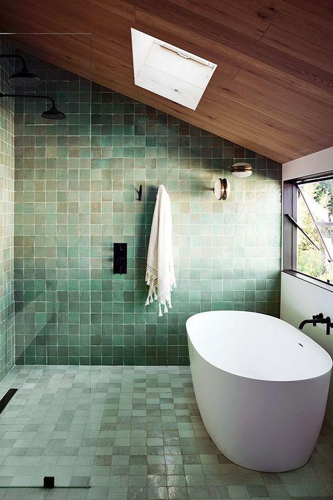 bathroom with green tiles and skylight