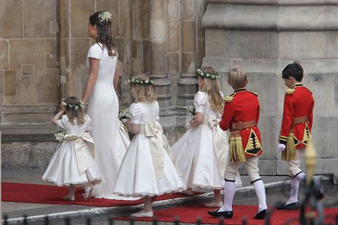 pippa middelton, sister of the bride kate middleton, arrives to the wedding of britains prince william and kate middleton, with young bridesmaids, in central london photo by brooks kraft llccorbis via getty images