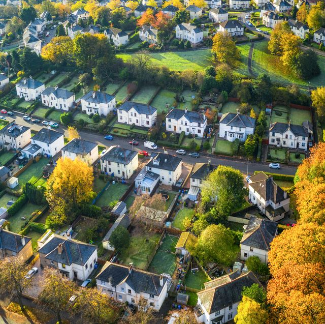 an autumn aerial view of detached suburban houses and gardens in the southside of glasgow, scotland