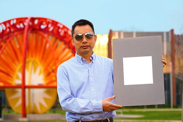xiulin ruan, a purdue university professor of mechanical engineering, holds up his lab's sample of the whitest paint on record purdue universityjared pike