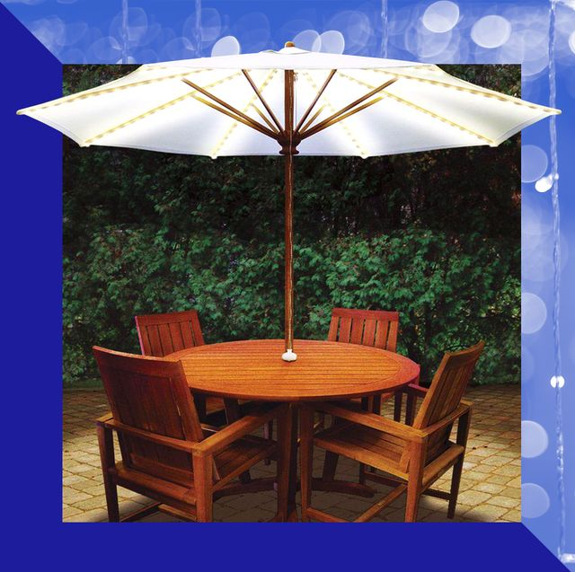 patio table and chairs with white umbrella with lights