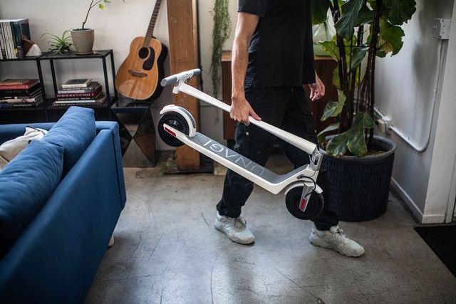 man holding unagi electric scooter