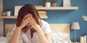 Unhappy girl in a bedroom