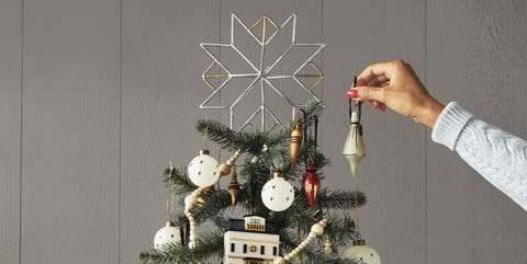 5232abc4e75f 35 Unique Christmas Tree Toppers - Cool Ideas for Tree Toppers