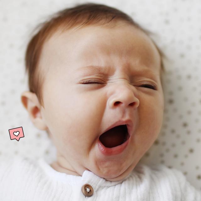 a baby yawning