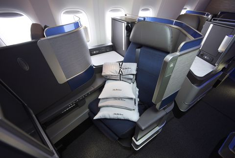 Airline, Aircraft cabin, Head restraint, Vehicle, Airplane, Car, Air travel, Auto part, Airliner, Aircraft,