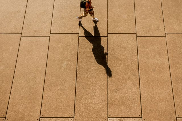 a high angle view of a long shadow of a person walking in sydney city