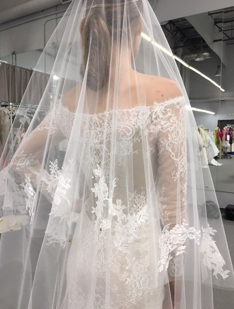 a close up of the veil and back details in the custom gown monique lhuillier designed for fifty shades dakota johnson