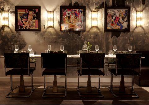 Room, Interior design, Furniture, Lighting, Table, Building, Chair, Antique, Light fixture, Art,