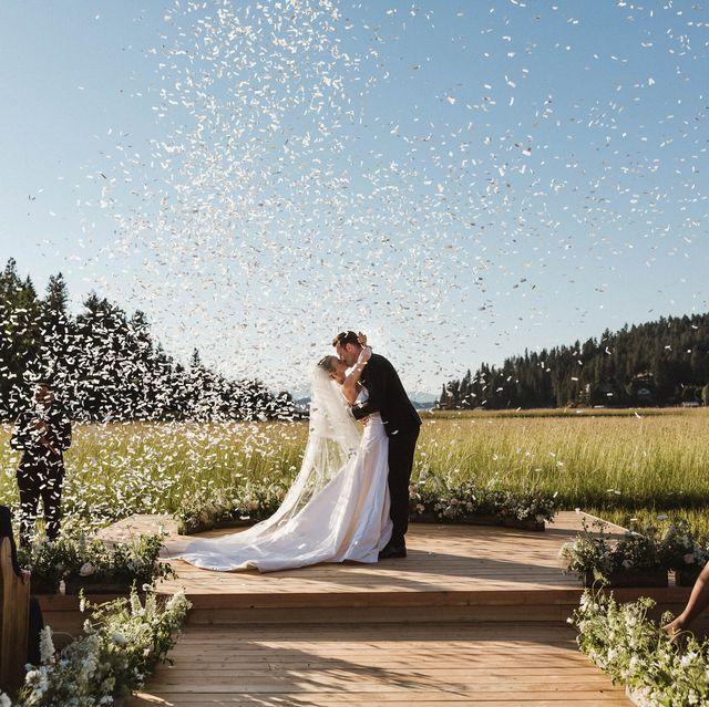 Photograph, Wedding dress, Bride, Ceremony, Wedding, Bridal clothing, Bridal veil, Marriage, Veil, Dress,