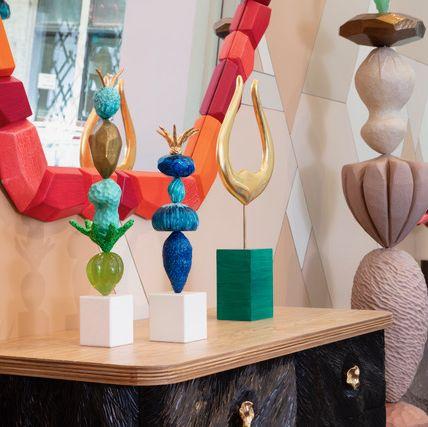 Turquoise, Room, Wood, Interior design, Furniture, Fashion accessory, Table, Art, Shelf, Sculpture,