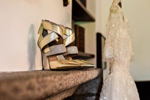 Dress, Yellow, Footwear, Shoe, Room, Architecture, Photography, Gown, Wedding dress, Fashion accessory,