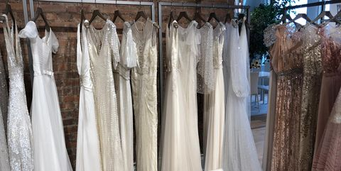 Clothing, Dress, Gown, Wedding dress, Boutique, Room, Bridal clothing, Textile, Curtain, Bridal party dress,