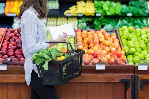woman shops for produce in supermarket