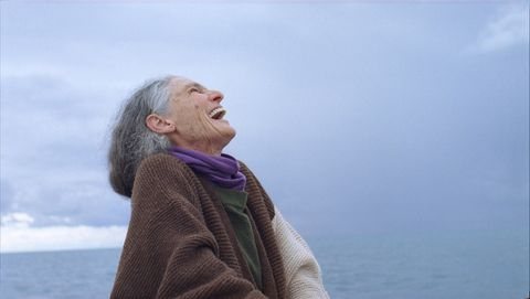 Facial expression, Sky, Blond, Sea, Human, Happy, Outerwear, Photography, Smile, Neck,