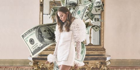 a fashion forward bride, with the design of dollar bills in the background