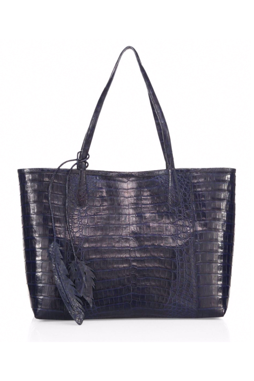 cab5247f0197 15 Luxury Beach Accessories - How the 1% Fill Their Beach Bags -