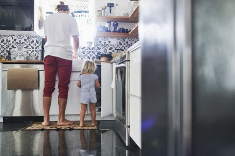 Father and daughter in kitchen at home