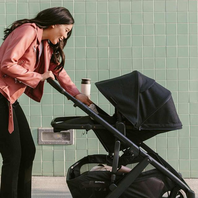 woman pushing baby in uppababy vista stroller