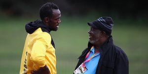 Usain Bolt y su entrenador Glen Mills