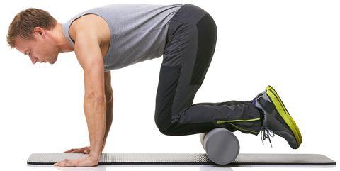 Using a foam-roller to strengthen his legs